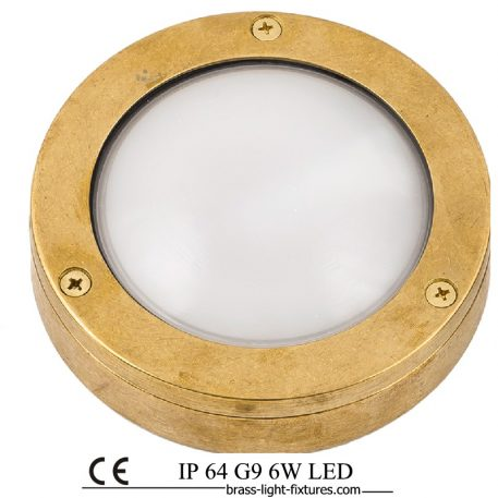 Round brass bulkhead with frosted glass.