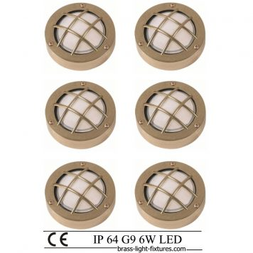 Moisture proof wall lights. Set of six decorative wall lights made of brass with a safety cage